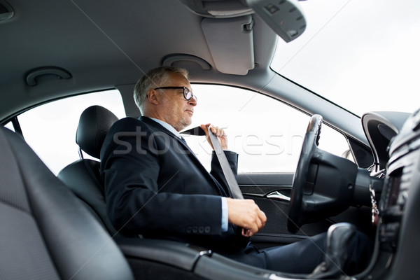 senior businessman fastening car seat belt Stock photo © dolgachov