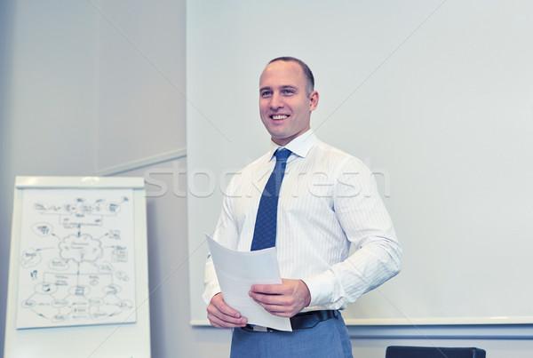 Sonriendo empresario presentación oficina gente de negocios hombre Foto stock © dolgachov