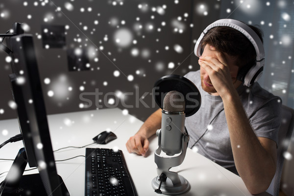 close up of man losing computer video game Stock photo © dolgachov