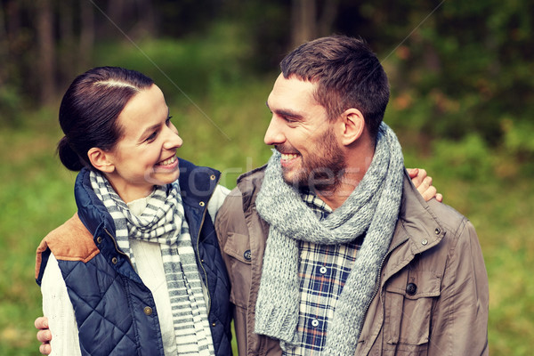 happy couple hugging at camp in woods Stock photo © dolgachov