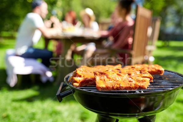 Hús főzés barbecue grill nyár buli szabadidő Stock fotó © dolgachov