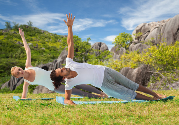couple doing yoga exercise outdoors Stock photo © dolgachov