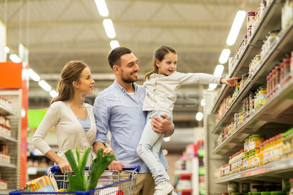 family with food in shopping cart at grocery store Stock photo © dolgachov
