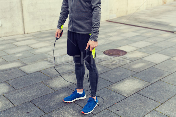 close up of man exercising with jump-rope outdoors Stock photo © dolgachov