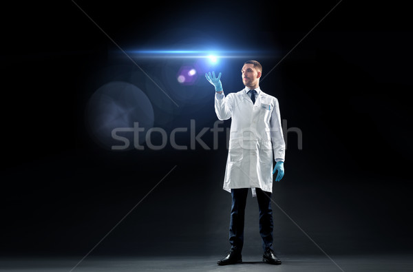 doctor or scientist in lab coat with laser light Stock photo © dolgachov