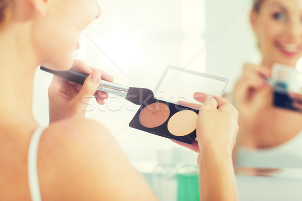 woman with makeup brush and foundation at bathroom Stock photo © dolgachov
