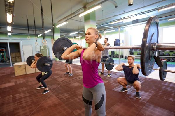 グループの人々  訓練 ジム フィットネス スポーツ 行使 ストックフォト © dolgachov