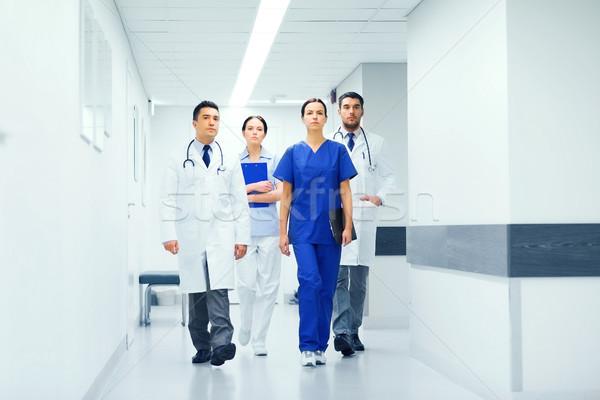 Stock photo: group of medics or doctors at hospital corridor
