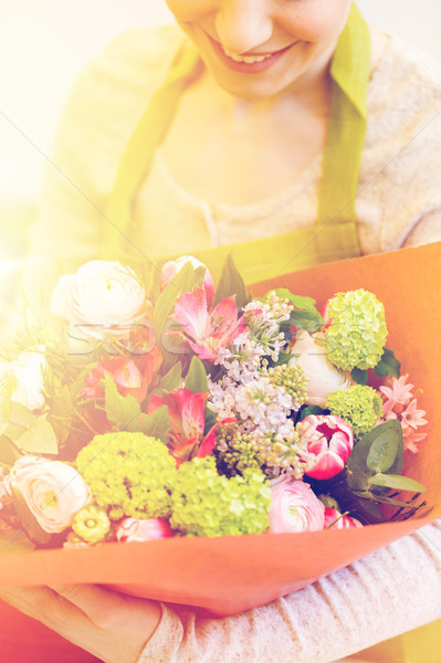 close up of woman with bunch at flower shop Stock photo © dolgachov