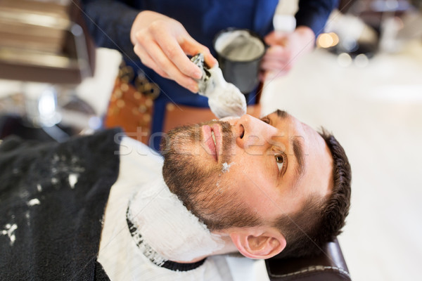 человека парикмахера пена борода люди Сток-фото © dolgachov