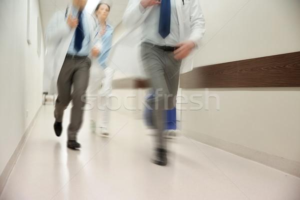 close up of medics or doctors running at hospital Stock photo © dolgachov
