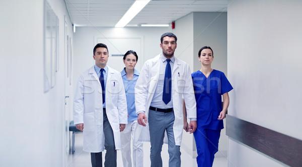 group of medics walking along hospital Stock photo © dolgachov