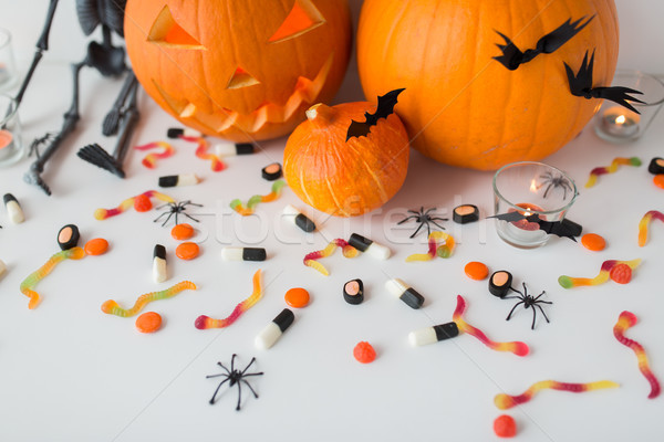 carved halloween pumpkins and candies Stock photo © dolgachov
