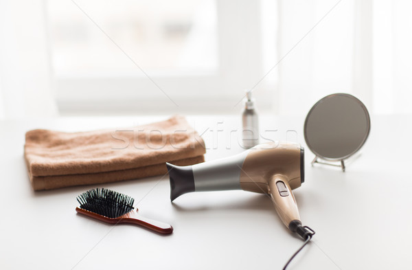 Stock photo: hairdryer, hair brushes, mirror and towel
