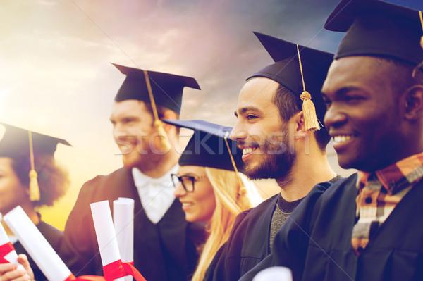 Feliz estudiantes educación graduación personas grupo Foto stock © dolgachov