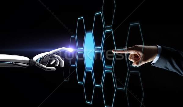 robot and human hand touching network hologram Stock photo © dolgachov