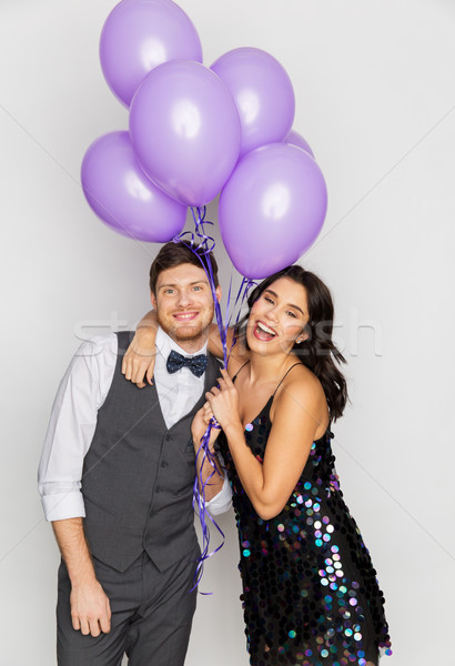happy couple with ultra violet balloons at party Stock photo © dolgachov