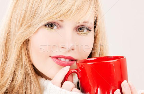 happy teenage girl with red mug Stock photo © dolgachov