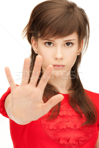 teenage girl making stop gesture Stock photo © dolgachov