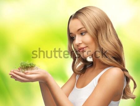 Kadın yeşil ot avuç içi parlak resim kız Stok fotoğraf © dolgachov