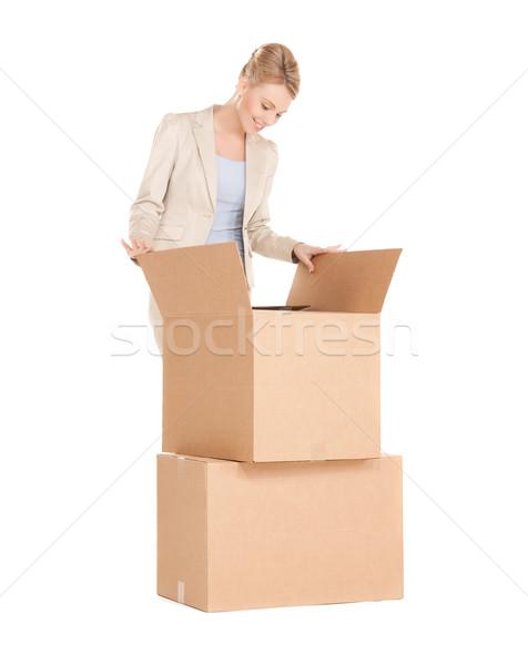 businesswoman unpacking big boxes Stock photo © dolgachov