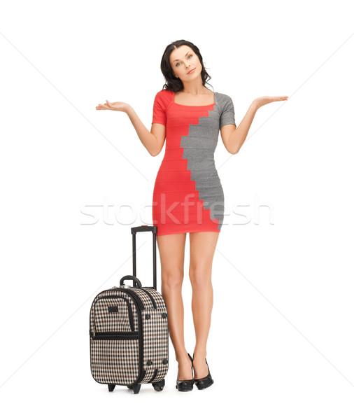 doubting woman with suitcase Stock photo © dolgachov