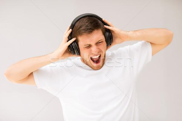 человека наушники прослушивании громко музыку молодым человеком Сток-фото © dolgachov