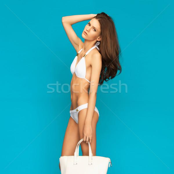 Model poz beyaz bikini çanta resim Stok fotoğraf © dolgachov