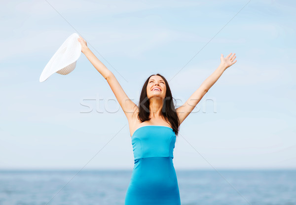 girl with hands up on the beach Stock photo © dolgachov