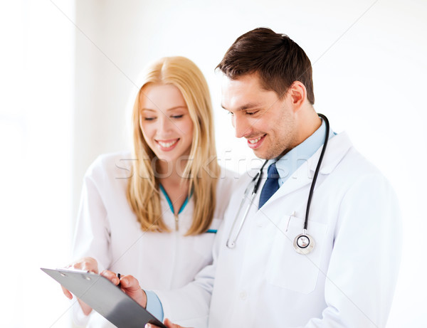 Dois médicos escrita prescrição saúde médico Foto stock © dolgachov