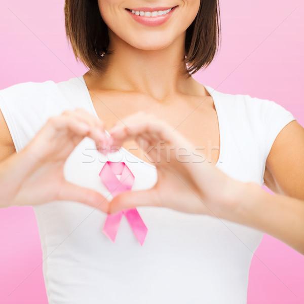woman with pink cancer ribbon Stock photo © dolgachov