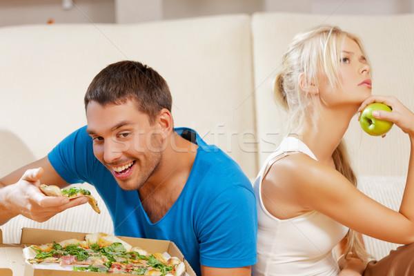 couple eating different food Stock photo © dolgachov