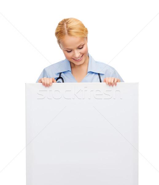 Sorridente feminino médico enfermeira conselho saúde Foto stock © dolgachov