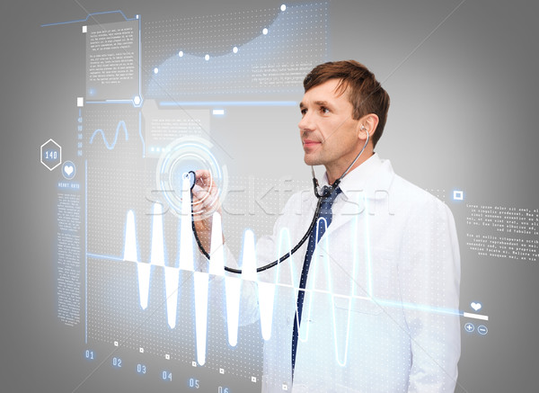 male doctor with stethoscope and cardiogram Stock photo © dolgachov