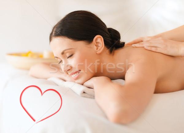 smiling woman in spa salon getting massage Stock photo © dolgachov