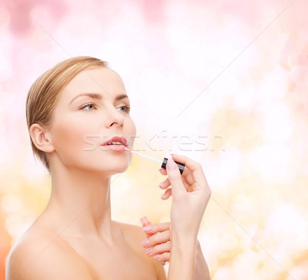 Stock photo: beautiful woman with lipgloss