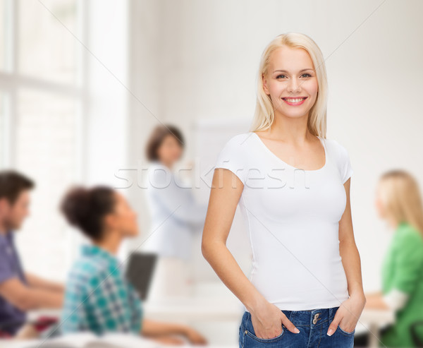 smiling woman in blank white t-shirt Stock photo © dolgachov