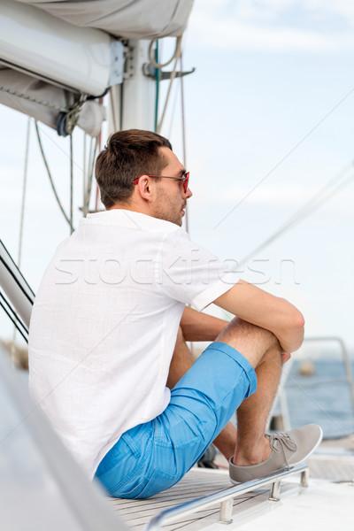 Człowiek posiedzenia jacht pokład wakacje wakacje Zdjęcia stock © dolgachov