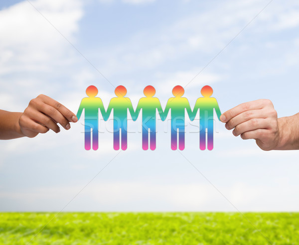 close up of hands holding paper chain gay people Stock photo © dolgachov