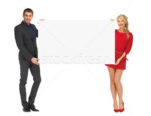 couple holding big blank white board Stock photo © dolgachov