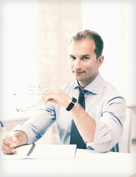 Empresario gafas escrito cuaderno Foto guapo Foto stock © dolgachov