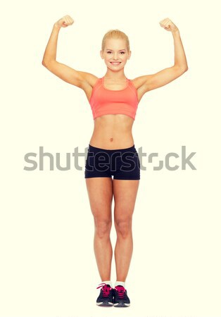 Souriant femme biceps fitness sport Photo stock © dolgachov