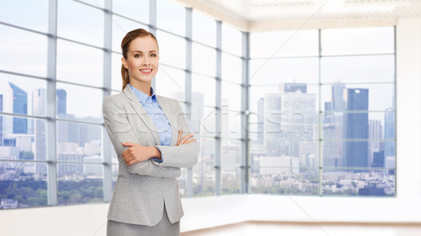 smiling businesswoman with crossed arms Stock photo © dolgachov