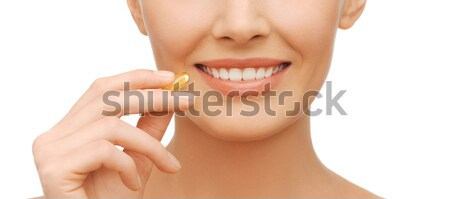 beautiful woman with omega 3 vitamins Stock photo © dolgachov