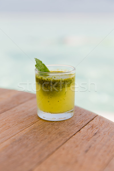 glass of fresh juice or cocktail on table at beach Stock photo © dolgachov
