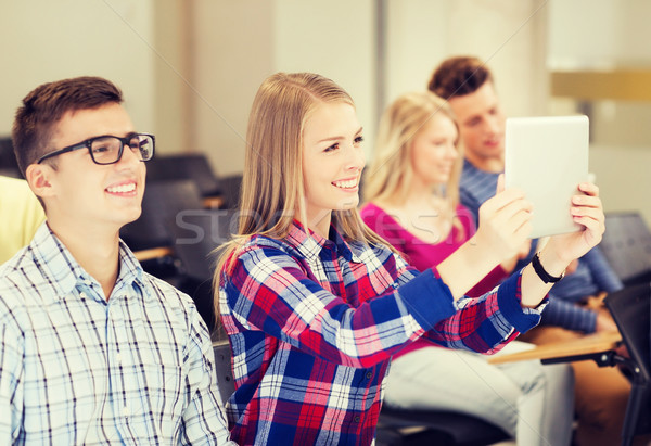 group of smiling students with tablet pc Stock photo © dolgachov