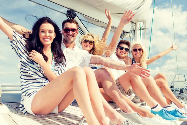 улыбаясь друзей сидят яхта палуба приветствие Сток-фото © dolgachov
