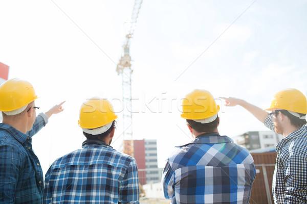 Groep bouwers bouwplaats business gebouw teamwerk Stockfoto © dolgachov