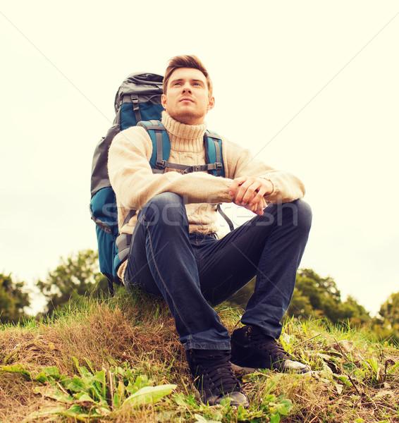 man with backpack hiking Stock photo © dolgachov