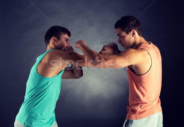 young men wrestling Stock photo © dolgachov
